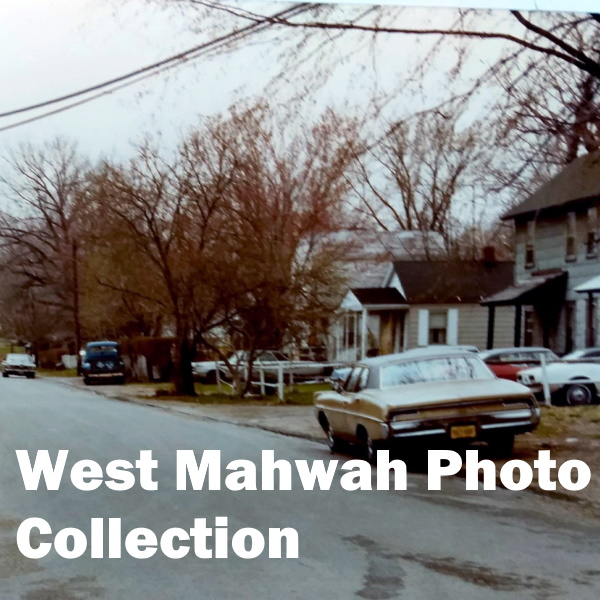 West Mahwah Photo Collection: White words over a color photo of a street scene with 1970s automobiles and a house