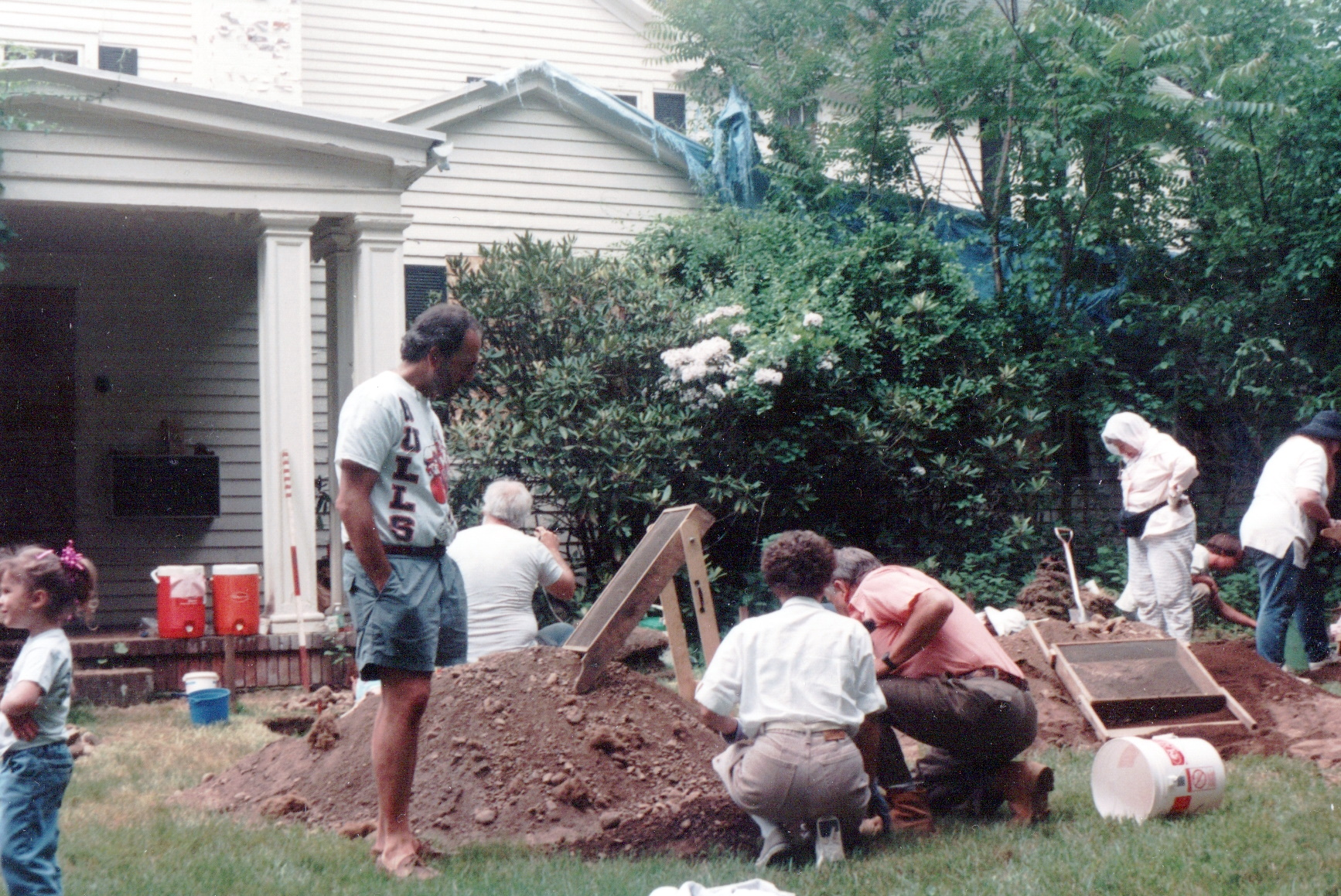 Color photograph of volunteers digging around the Sheffield House