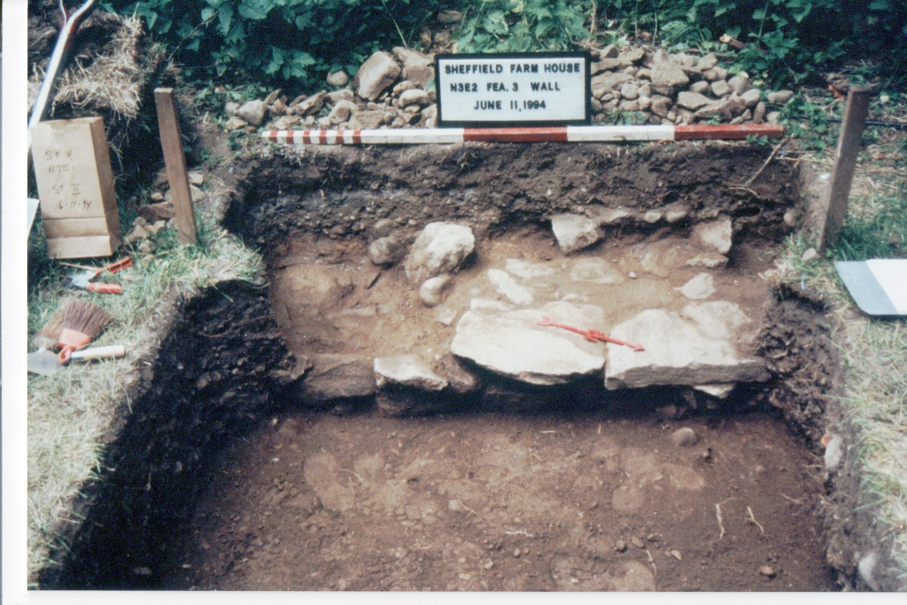 Color photo of an excavated portion of wall at the Sheffield House