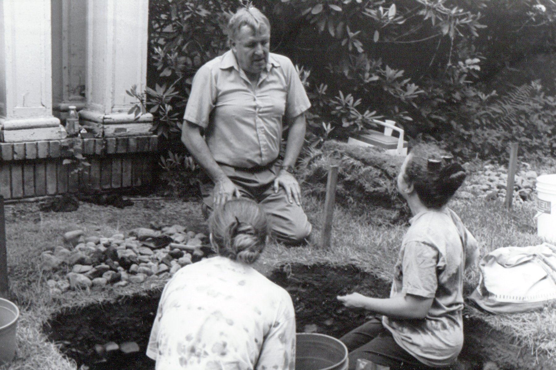 Black and white photograph of volunteers at an archeological dig
