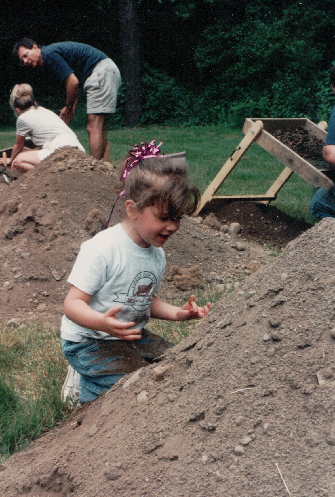 Color photo of a young girl at an archeological dig