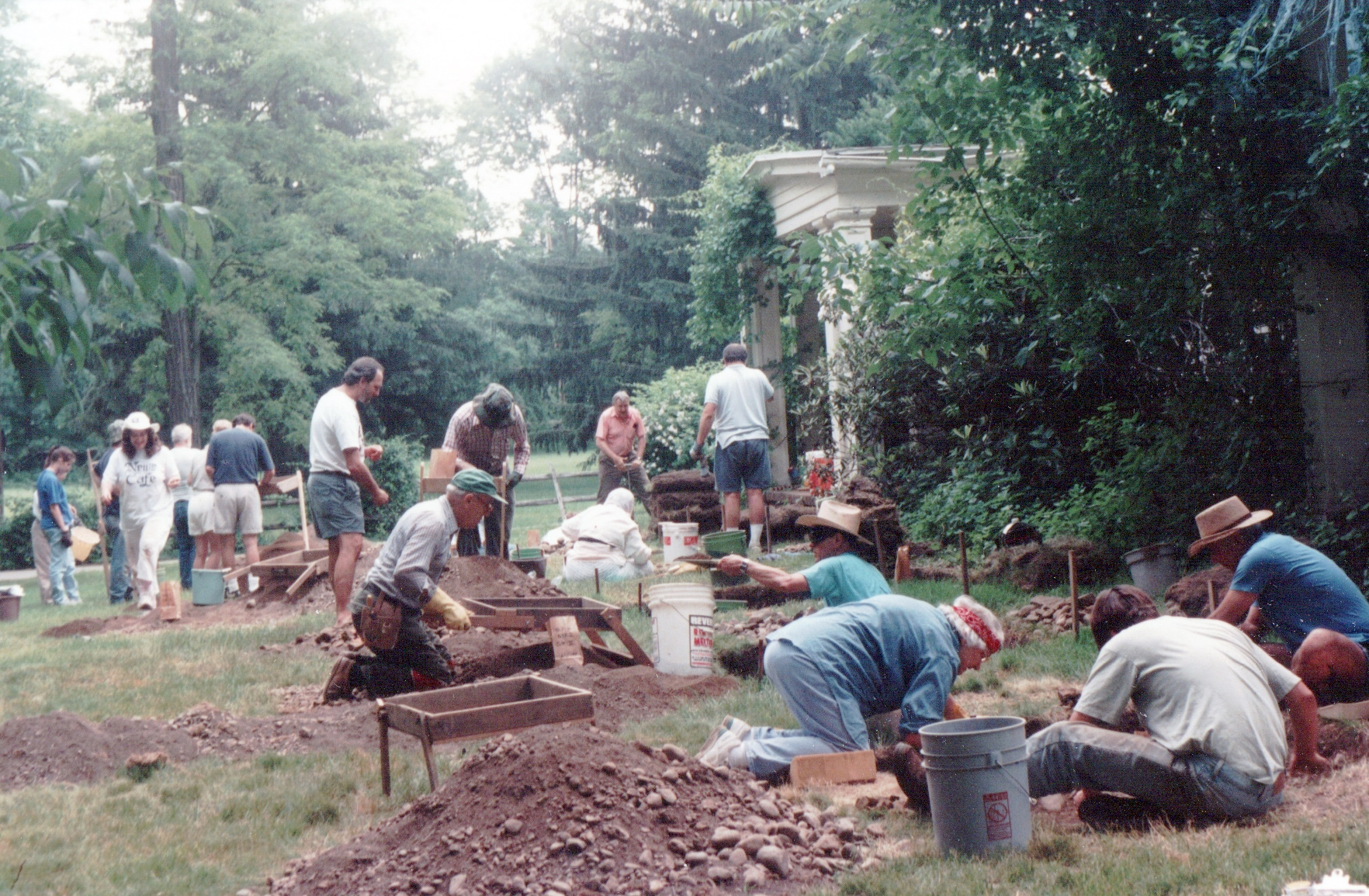 Color photograph of volunteers excavating a foundation at the Sheffield House